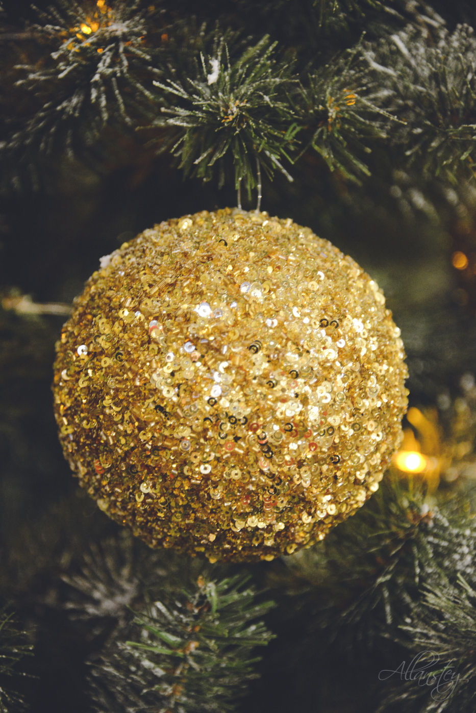 Golden glitter Christmas ball decoration closeup on Christmas tree