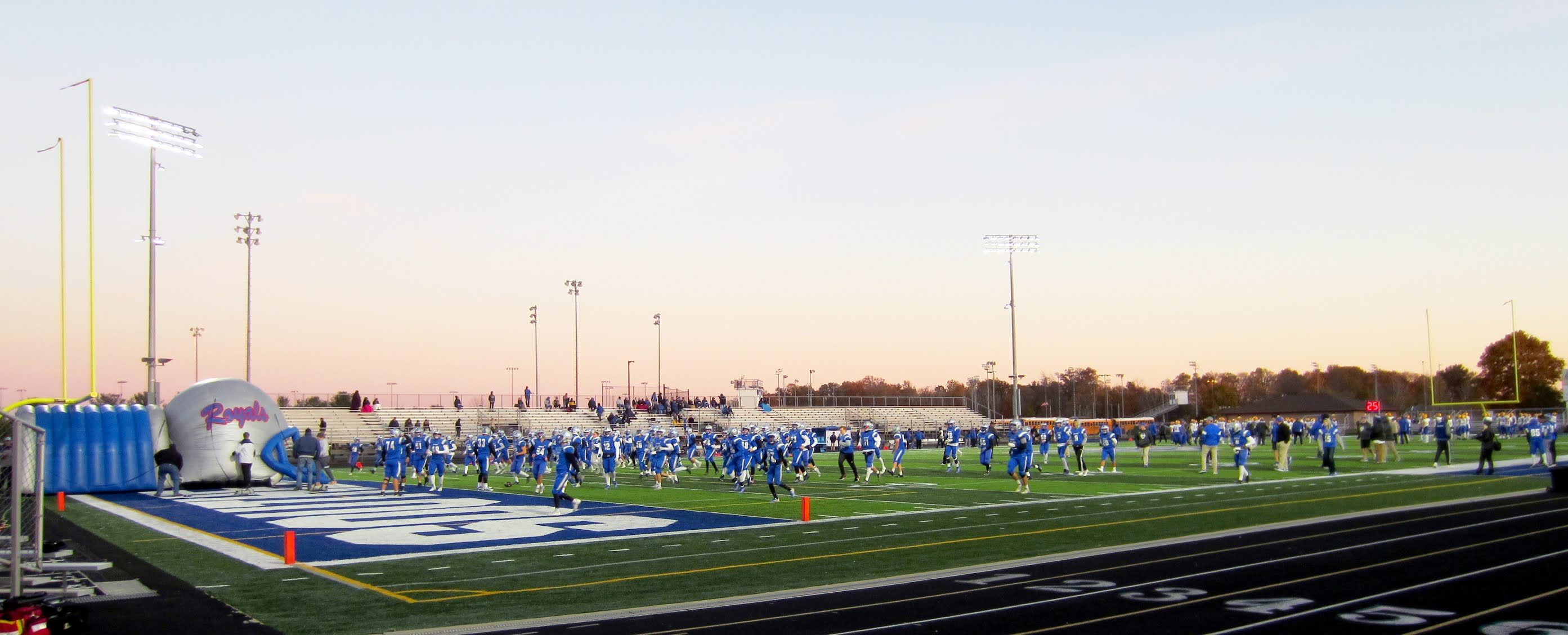 Hamilton Southeastern Royals players warm up on the field