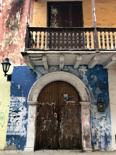 Vintage Wooden Door and Blue Facade under a blacony in Cartagena