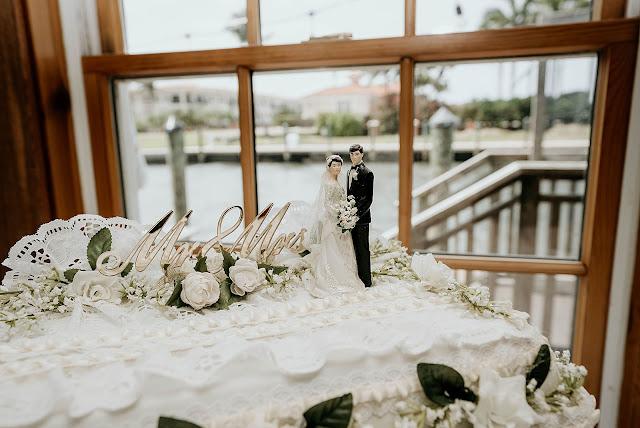 Detail shot of wedding cake topper on cake