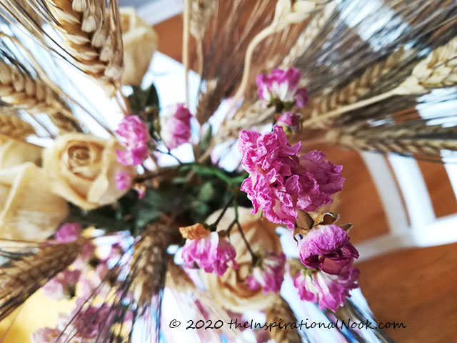Dried floral arrangement with preserved dried roses and black beard wheat.