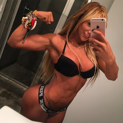 hot girl flexing muscles