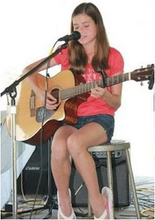 Girl with guitar experience intrument on online solo music