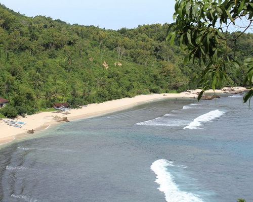 Tinuku.com Wediombo beach in Gunung Kidul, the hidden paradise for surfing and snorkeling on white sand and coral reefs
