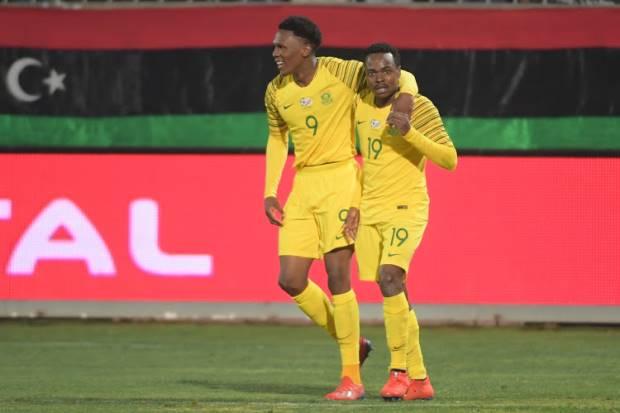Bafana Bafana players Lebo Mothiba and Percy Tau hugging after a goal
