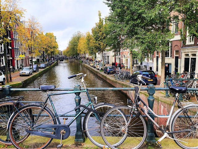 Bikes on bridge over canals in Amsterdam