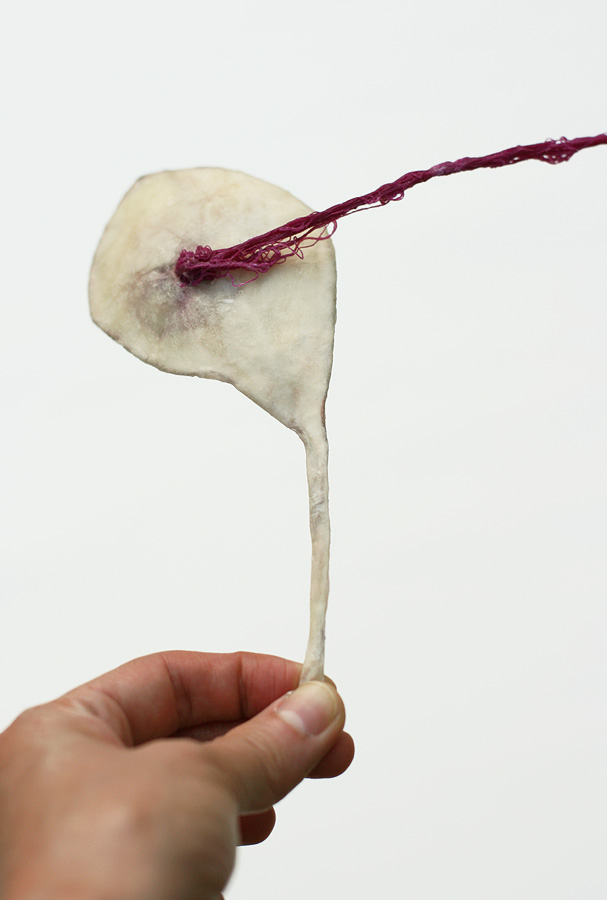 A Cleansing [2011], Offerings series, ongoing. beeswax, thread, paper & wire. 34.5 x 16.5 x 3.5 cm
