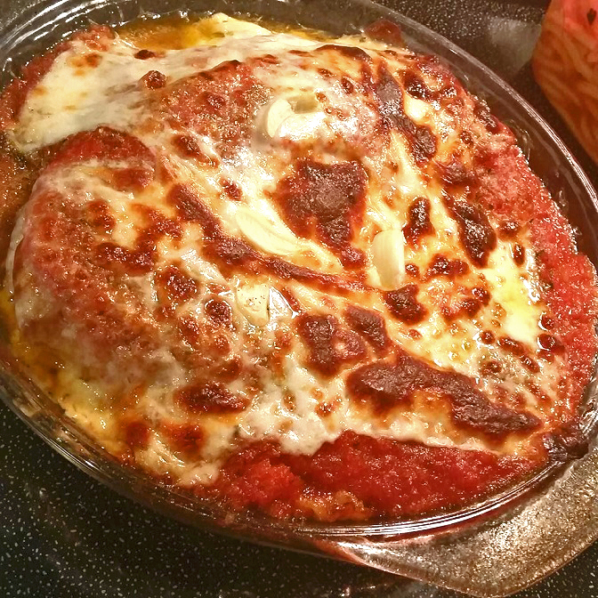 this is how to make Chicken Parmesan with homemade marinara sauce and melted mozzarella cheese on top