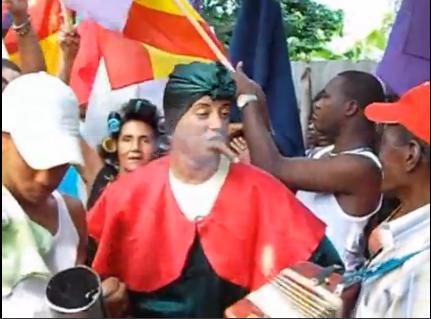 """Dominicanos honran con música, tabaco y """"romo"""" a San Miguel-Videos"""