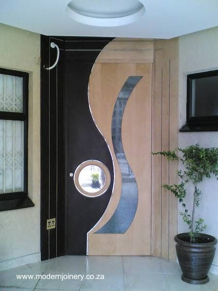 Arquitectura de casas puertas portones ventanas y for Puertas de metal con vidrio modernas