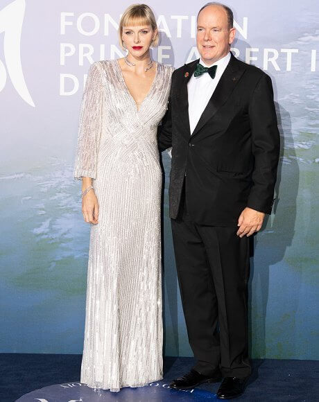 Princess Charlene wore a new v-neck sequin gown from Jenny Packham, and Brevis diamond necklace from Repossi. Pauline Ducruet red suit