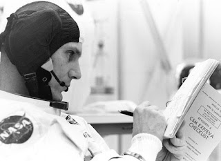 astronaut reviewing checklist