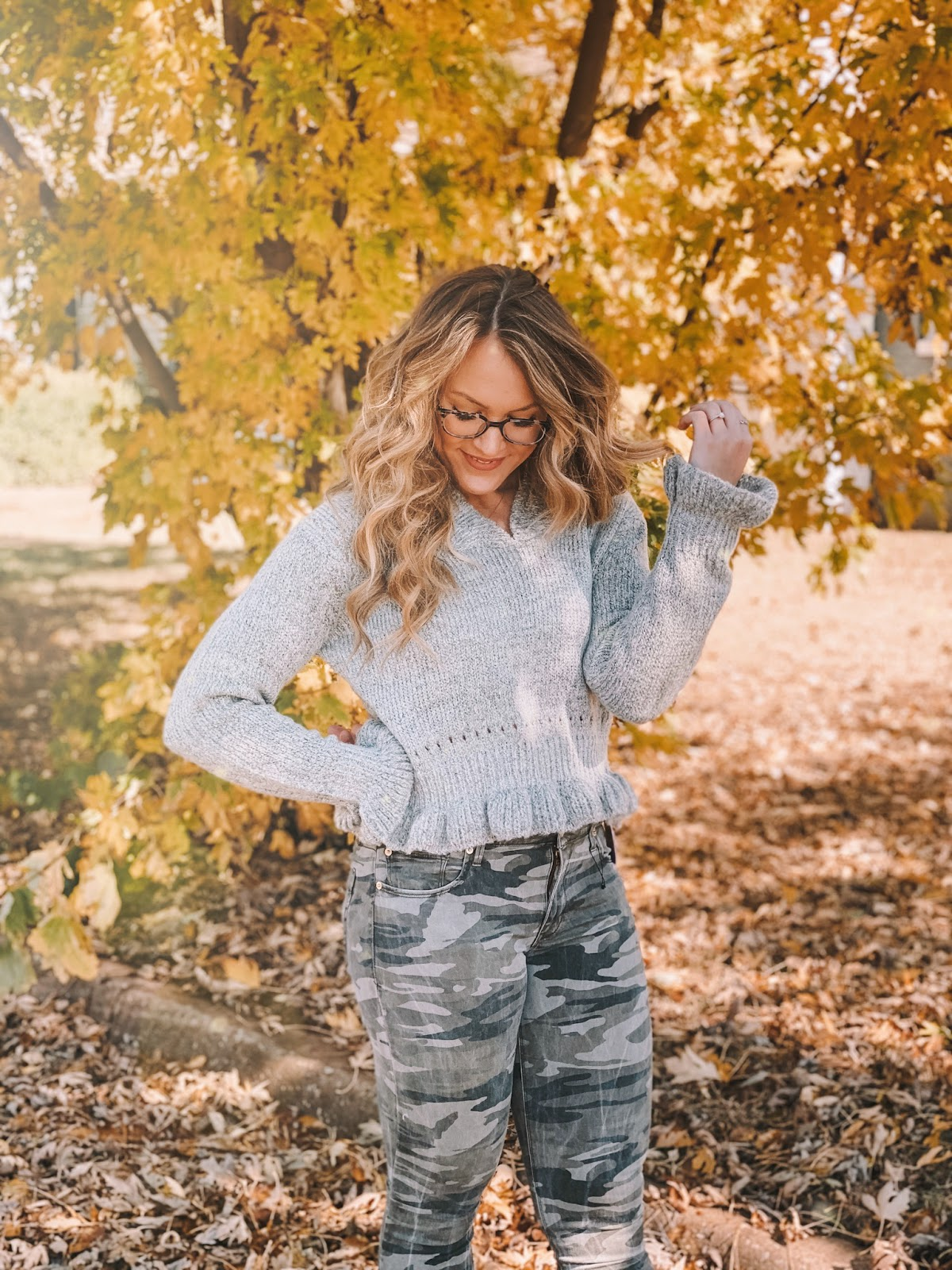 Oklahoma blogger Amanda Martin wears a camo jeans and grey ruffle sweater for thanksgiving