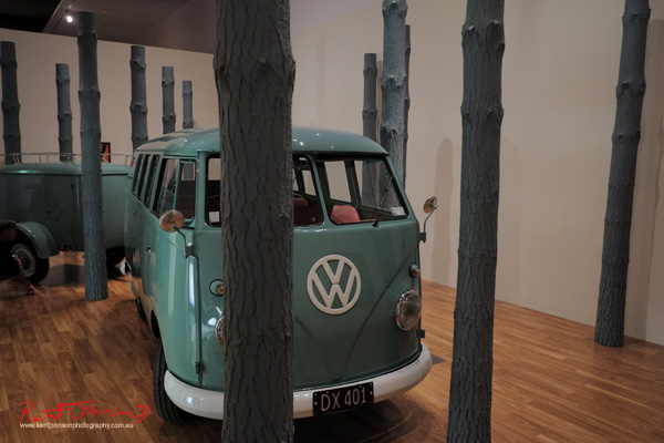 Combi van in forest, exhibition detail. MICHAEL PAREKOWHAI THE PROMISED LAND. Photo by Kent Johnson.
