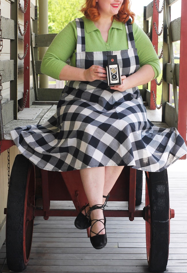 gingham overall dress with green blouse 1950s style outfit with vintage camera by va-voom vintage