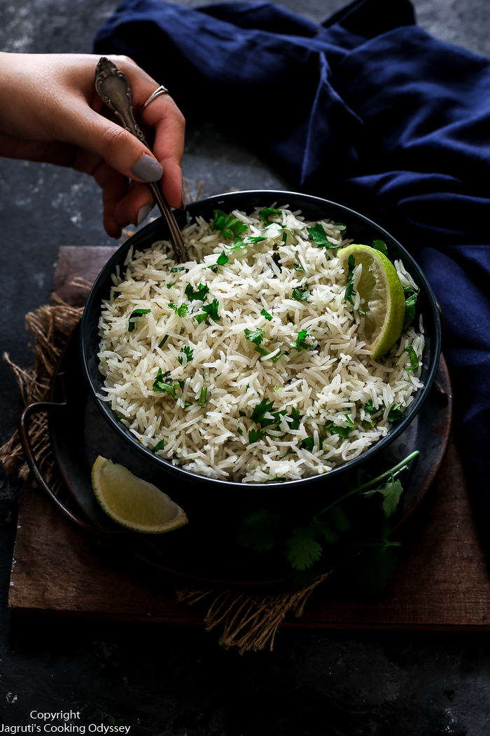 Image of coconut rice served with lime wedges