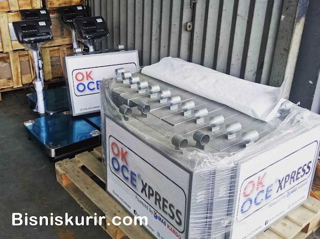 Kelengkapan kerja Timbangan dan neon sign Ok Oce Express
