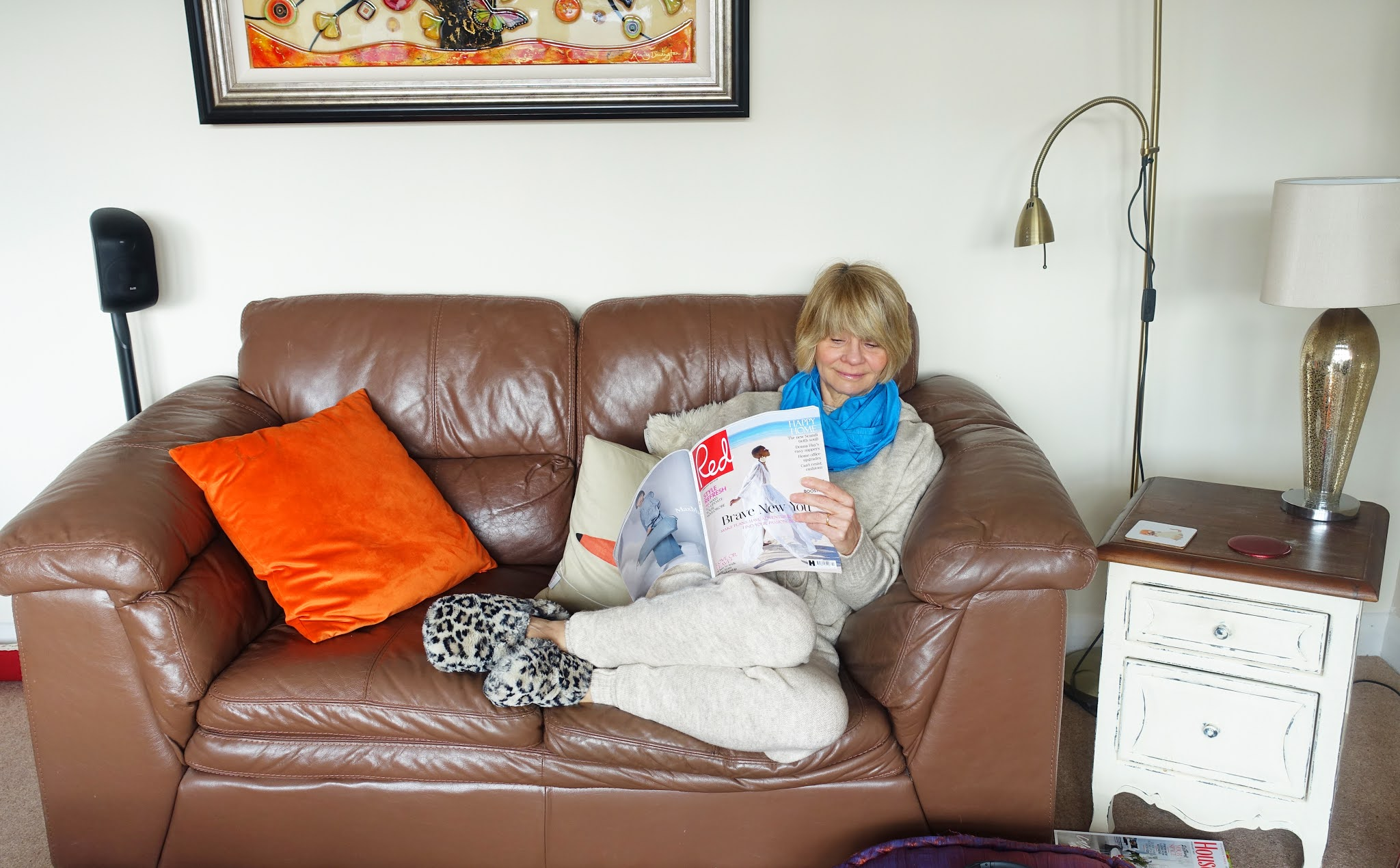 For the Style Not Age Challenge Lounging at Home - very apt for lockdown - Is This Mutton blogger Gail Hanlon is wearing a wool hoody and joggers in oatmeal from Mango with an infinity scarf in Chinese Blue for a dash of colour from Kettlewell