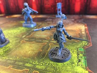 An Escher ganger strides into battle in Necromunda: Underhive.