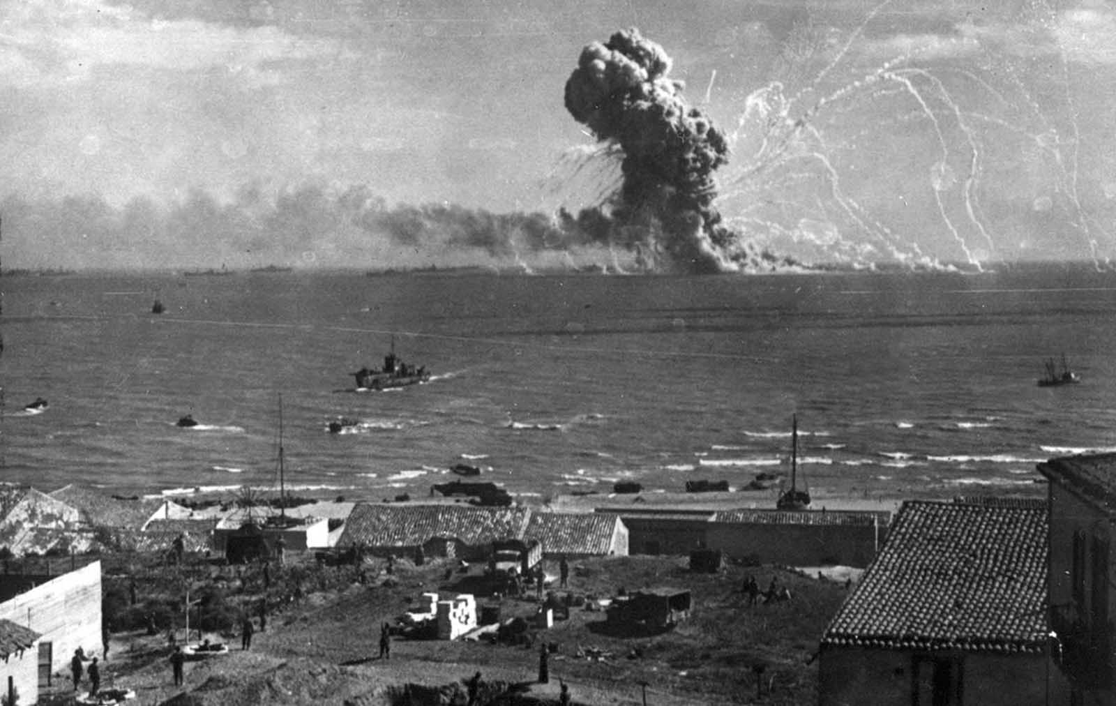 During the invasion of Sicily by Allied forces, an American cargo ship, loaded with ammunition, explodes after being hit by a bomb from a German plane off Gela, on the southern coast of Sicily, on July 31, 1943.