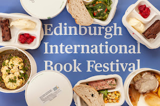 Edinburgh International Book Festival writing in white on blue surrounded by plates of food