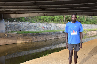 Wilson Komen standing beside the C and O Canal in Georgetown