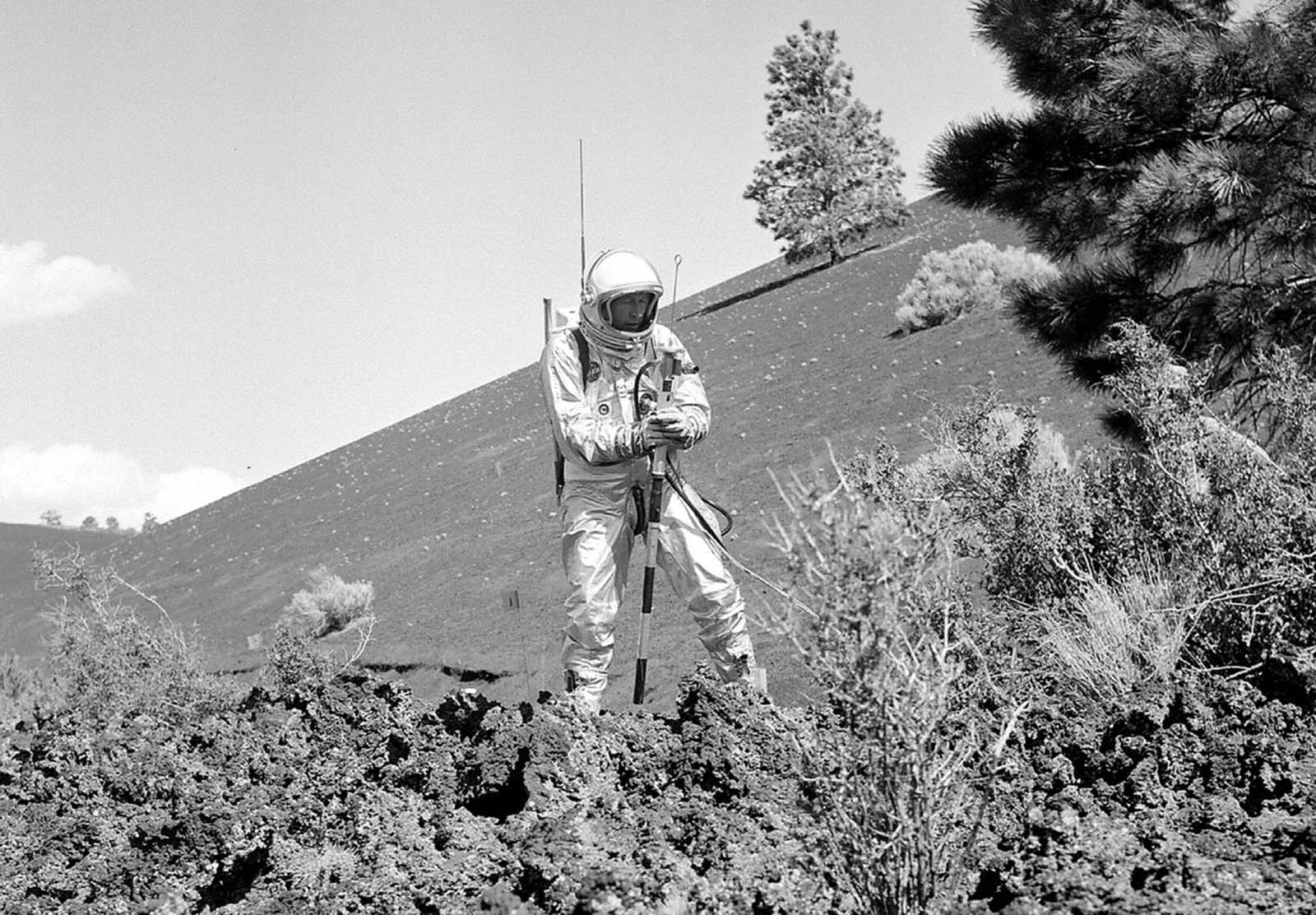 A suited subject stands on the edge of the Bonito Lava Flow near Arizona's Sunset Crater volcano, with an early concept of a
