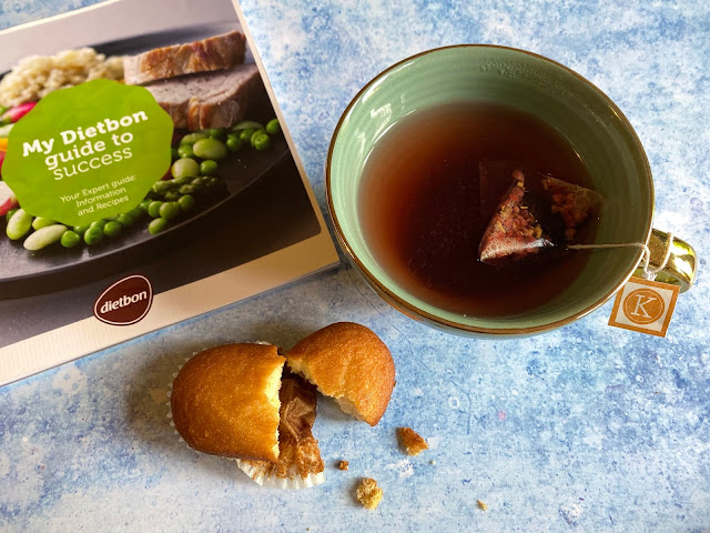 Snack time: A Dietbon mini lemon cake next to a booklet and mug of tea