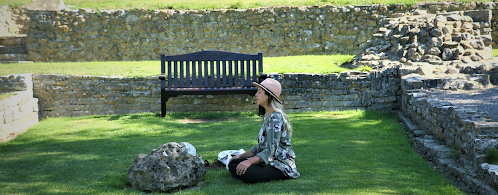 Picture of a woman meditating in a garden