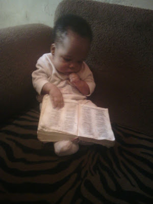 baby boy reading bible