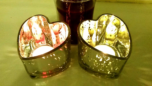 Pink and green candles in heart shaped holders