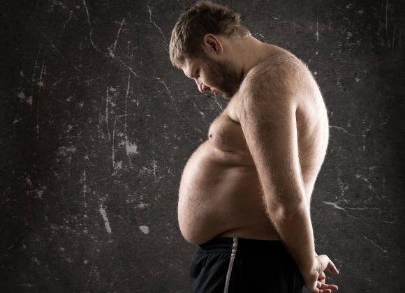 overweight man looking dejected