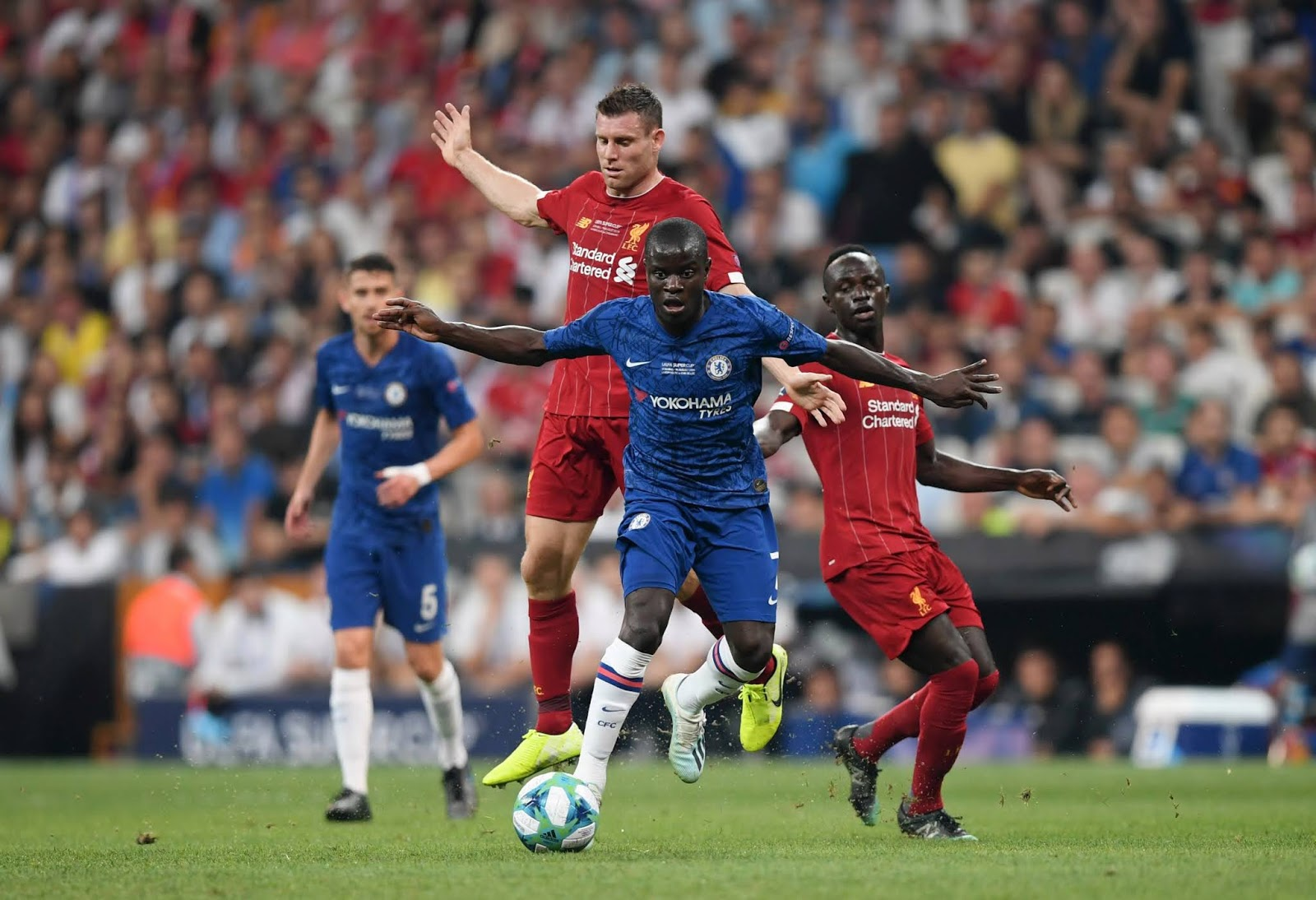 N'Golo Kante and James Milner battle for possession in midfield