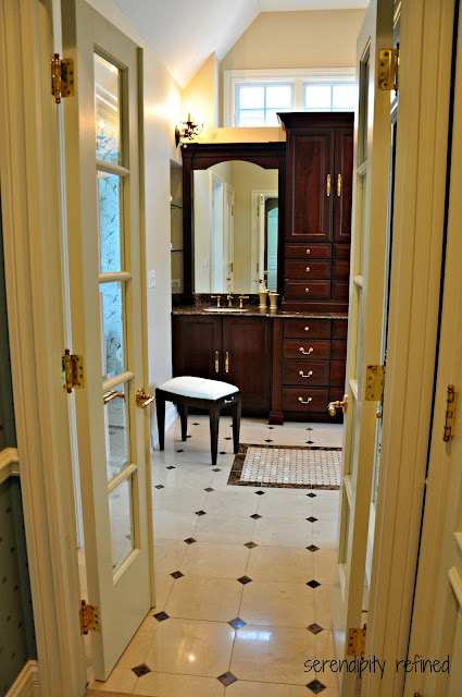 French doors to bathroom Dark Wood Master Bathroom Cabinets, Sconces, Mirrors Tile, Glass Shelves, Crema Marfil Marble, Emperador Dark Granite, shower, tile rug, mosaic, tub surround