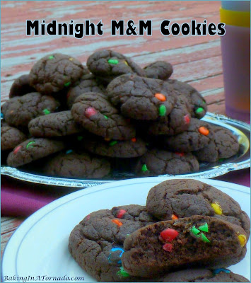 Lower in fat than most cookies, Midnight M&M Cookies are still full of chocolate flavor. Mini M&Ms add a crunch in every bite. | Recipe developed by www.BakingInATornado.com | #recipe #chocolate