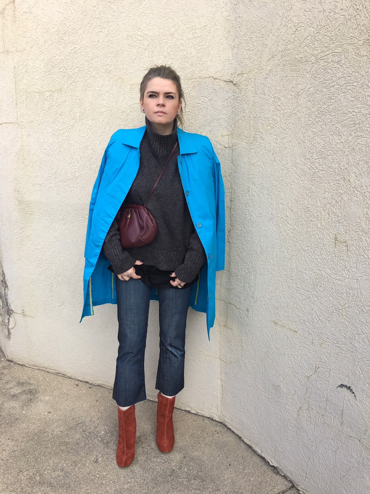 a blue coat and rust orange color suede ankle boots