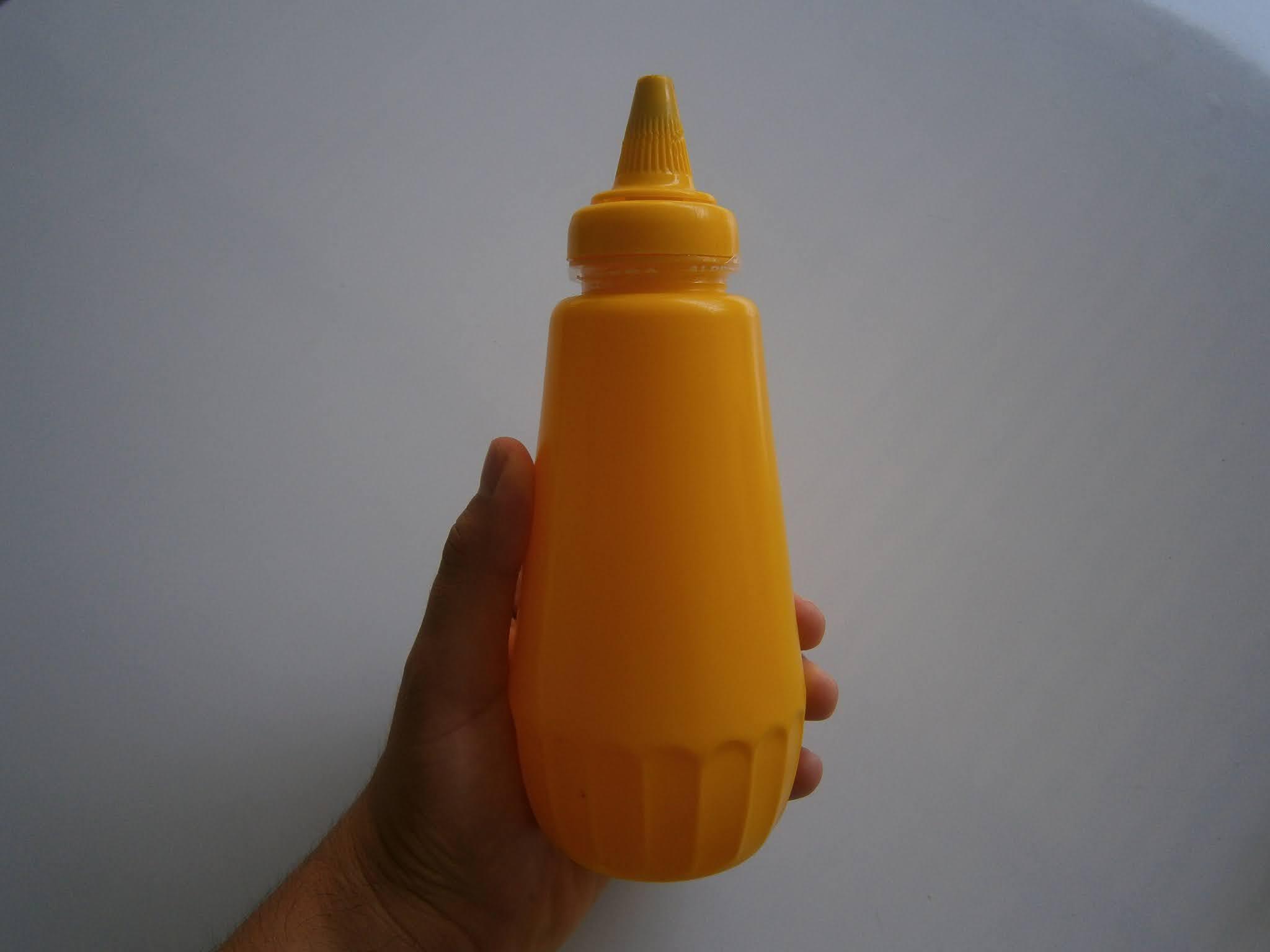 Contenedor de ají usado por pollerias