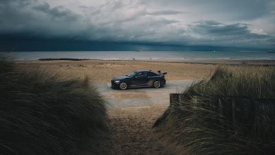 Beach, car, sand, storm, clouds, skyline