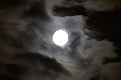 super moon through clouds