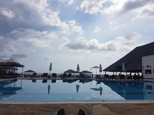 A view of Amman Bungalow's swimming pool into the ocean. The pool is built on sort of a raised platform  to provide an unobstructed view into the ocean and with gazebos around it