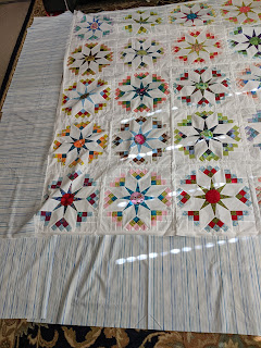 The border fabric is laid around the quilt to see how it might look