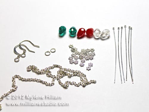 Jewelry components for making Bud light earrings: green, red and clear teardrop crystals, silver chain and jewelry findings.