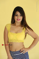 Cute Telugu Actress Shunaya Solanki High Definition Spicy Pos in Yellow Top and Skirt  0146.JPG