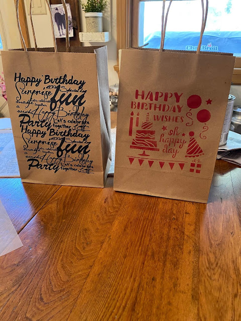 Photo of plain gift bags with a rub on transfer & a stencil
