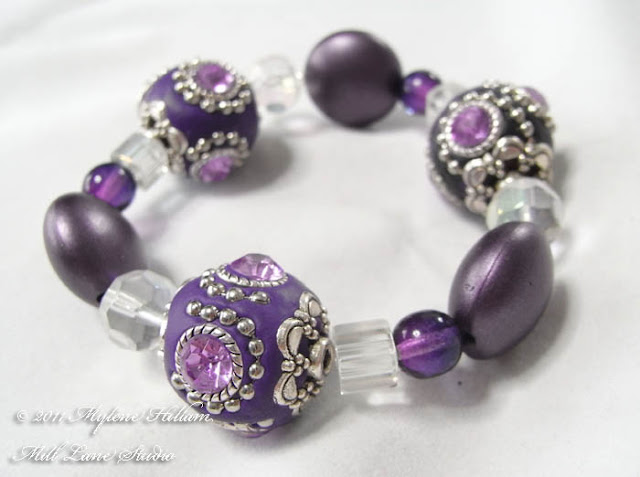 Simple design, stunning beads! Purple Kashmiri bead stretch bracelet