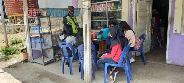 Edukasi Covid-19, Personel Jajaran Kodim 0207/Simalungun Berikan Himbauan Kepada Warga Patuhi Protokol Kesehatan