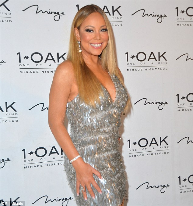 Mariah Carey flashes stunning engagement ring as she steps out in sexy dress