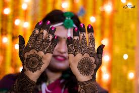 What does henna symbolize in weddings? When should you get henna before wedding? What does henna symbolize? How long does the process of applying henna to a bride take? significanceofmehndi in hindu wedding, hennawedding tradition, mehndi wedding, mehendi design, mehndi ceremony, historyof henna, hennameaning, hennaspiritual meaning,