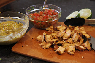 ingredients - guacamole in bowl, pico in bowl, shredded chicken on cutting board