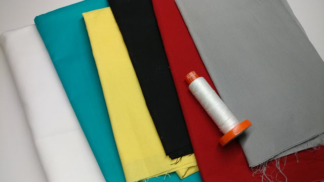 Solid fabrics to make ferry quilt block
